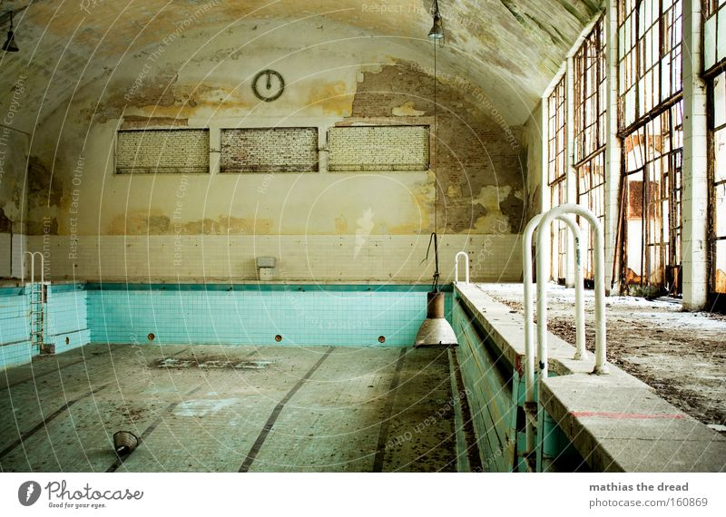 indoor swimming pool Indoor swimming pool Swimming pool Empty Gloomy Dirty Leaf Hall Clock Lamp Glazed facade Derelict Aquatics Grief Distress Non-swimmer