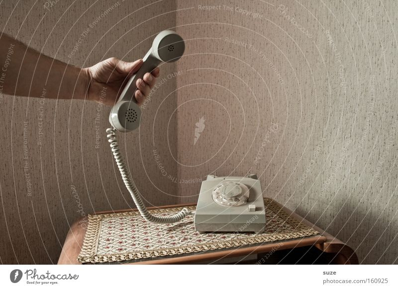 It's for you! Living or residing Flat (apartment) Telecommunications To talk Telephone Arm Hand To hold on Communicate To call someone (telephone) Old Retro