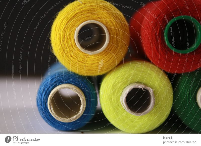 Blue Red Yellow Colour Multiple Round Hollow Stack Sewing thread Coil Section of image Partially visible Vista Sewing Consecutively