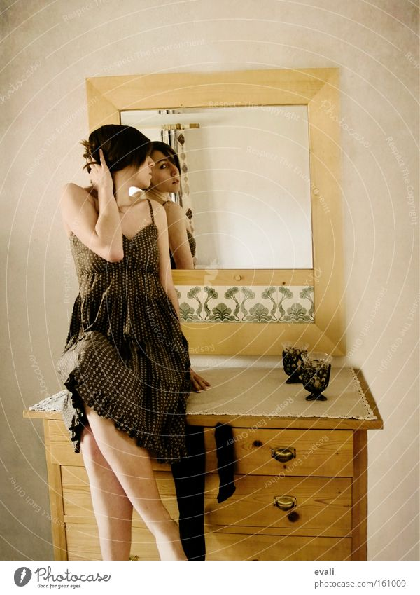 In the mirror Furniture Mirror Human being Feminine Young woman Youth (Young adults) Woman Adults 1 Clothing Dress Sit Cupboard Colour photo Interior shot Day