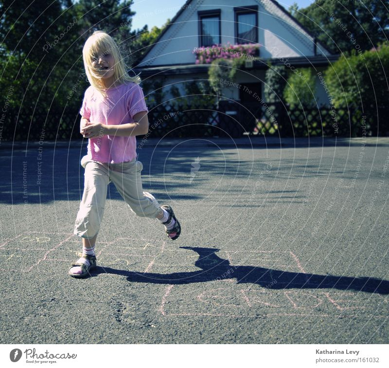 Human being Child Summer Joy Street Playing Movement Jump Infancy Blonde Walking Happiness Creativity Beautiful weather Fitness Serene