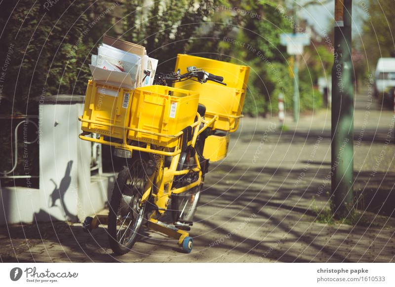 If the postman has twice ... Logistics Mail Town Cycling Yellow Bicycle Postman Sidewalk Delivery Mail order selling Letter (Mail) Colour photo Exterior shot