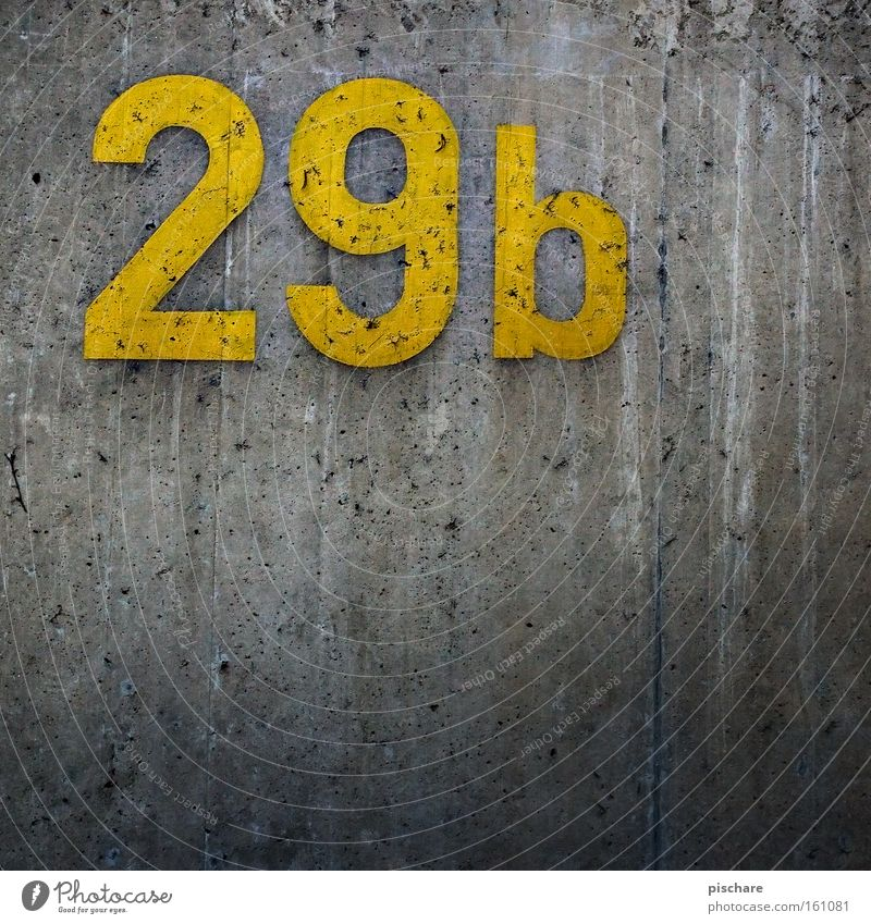 Just before 30 Construction site Wall (barrier) Wall (building) Concrete Digits and numbers Yellow Gray 20 9 House number Settlement pischarean Detail