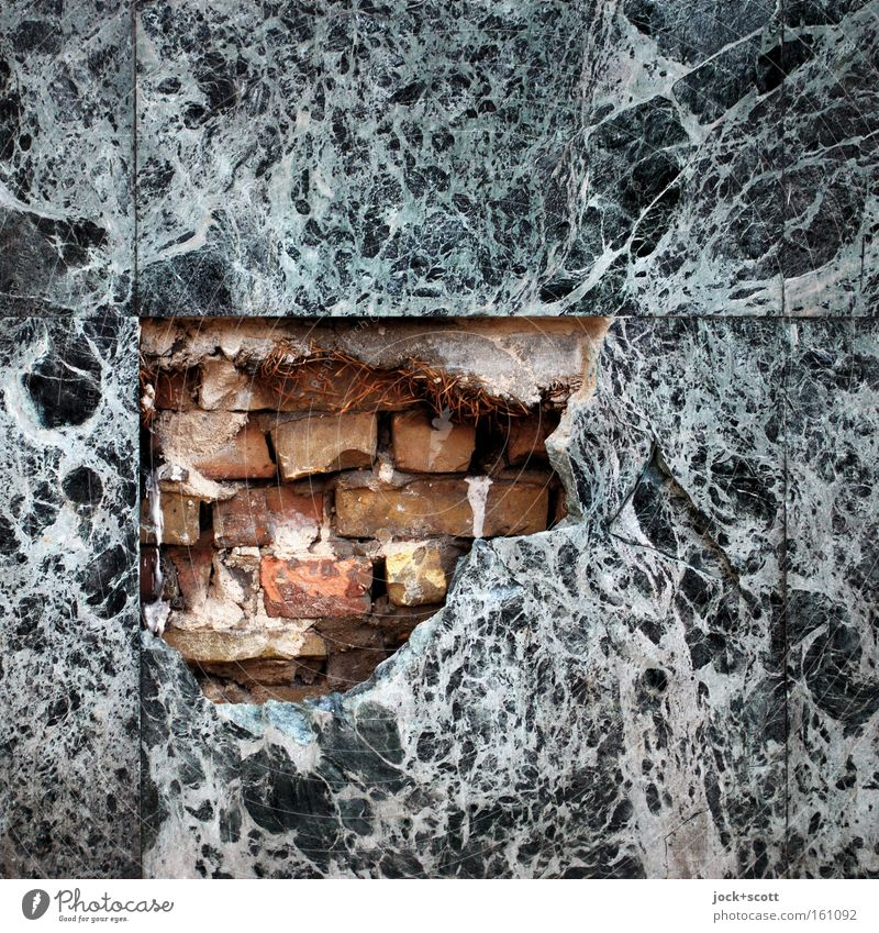 Marble, stone and iron breaks Architecture Wall (building) Facade Stone Brick Old Sharp-edged Firm Broken Moody Indifferent Esthetic Arrangement Feeble Seam