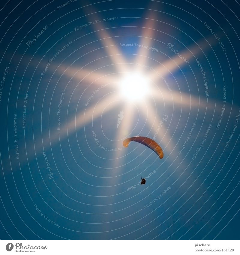 Sky Blue Summer Sun Sports Warmth Freedom Flying Leisure and hobbies Paragliding Parachute Flying sports Celestial bodies and the universe Weightlessness