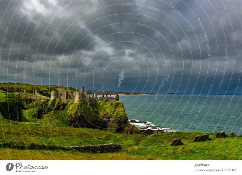 Dunluce Castle on the stormy coast of Northern Ireland Coast Landscape Ocean Travel photography Old Atlantic Ocean Ruin dunluce castle Fortress Past