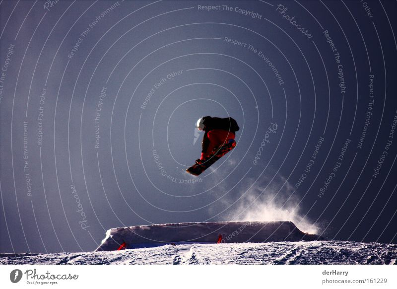 Ride the Snow Snowboard Air Style Jump Contrast Winter Blue Winter sports Sports Playing Exterior shot Colour photo 1 Tall Freestyle Snowboarder Snowboarding