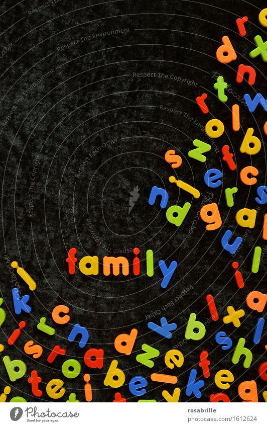 colourful family - colourful magnetic letters on black velvet with the word FAMILY in between Joy Playing Children's game Parenting Education Kindergarten