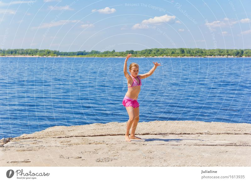 Dancing girl on the riverbank Human being Woman Child Blue Summer White Ocean Joy Girl Beach Adults Movement Playing Sand Pink Action