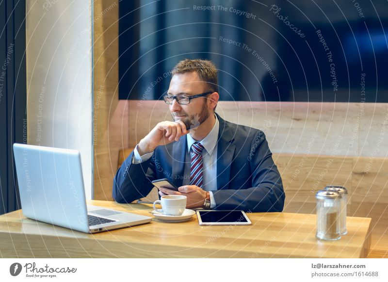 Businessman enjoying his coffee and working with his laptop Human being Man Face Adults Work and employment Modern Technology Computer Eyeglasses Telephone