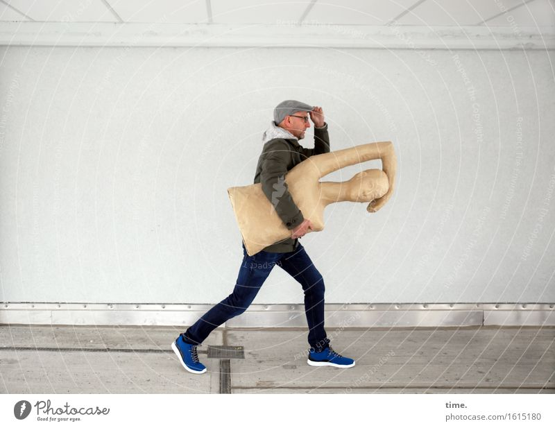 art to go Masculine 1 Human being Art Sculpture Wall (barrier) Wall (building) Jeans Jacket Cap Running To hold on Going Walking Carrying Exceptional Speed