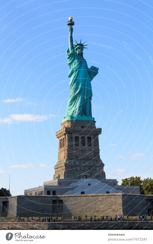 The Statue of Liberty in New York City Sky Vacation & Travel Blue Freedom Tourism Island Historic Symbols and metaphors USA Monument Interest Lady Vertical