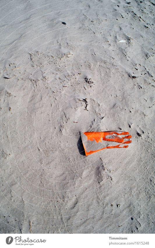 Give me your hand... Work and employment Environment Beach Denmark Gloves Work gloves Sand Plastic Lie Wait Gray Orange Exterior shot Deserted Day