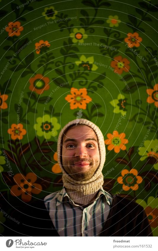 flower child Lighting Illuminate Hippie Man Facial hair Laughter Smiling Grinning Joy Flower Wallpaper Portrait photograph Funny Humor Cap Hooded (clothing)