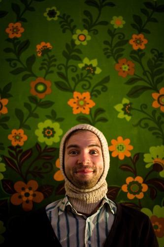 flower child Lighting Illuminate Hippie Man Facial hair Laughter Smiling Grinning Joy Flower Wallpaper Portrait photograph Funny Humor Cap Hooded (clothing)