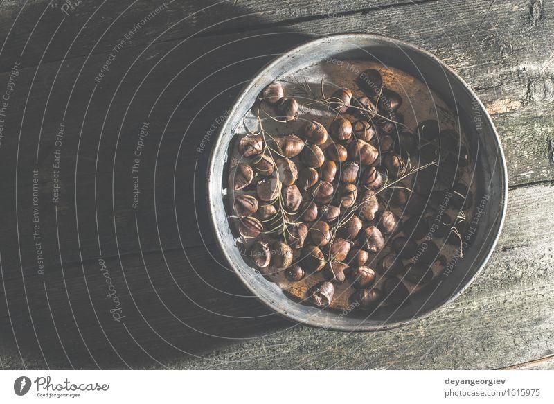 Roasted chestnuts. Vintage style Fruit Pan Cook Nature Autumn Leaf Brown Tradition Chestnut food vintage Snack sweet fall roasting seasonal Shell Seasons Tasty