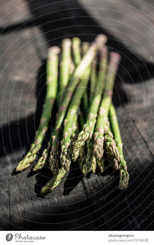 Asparagus on vintage table Vegetable Nutrition Vegetarian diet Diet Table Kitchen Wood Dark Fresh Delicious Green Organic Raw Ingredients Meal Rustic Gourmet