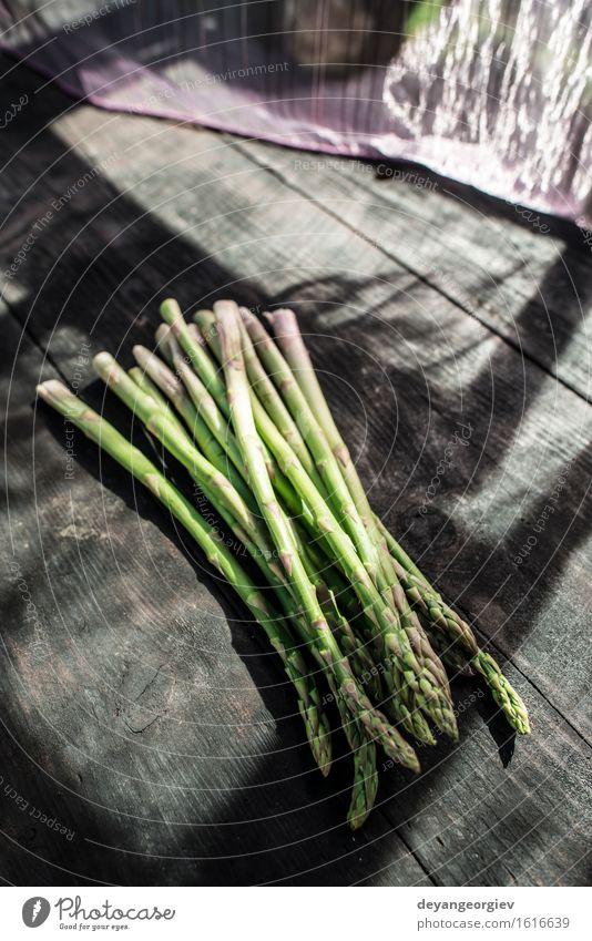 Asparagus on vintage table Vegetable Nutrition Vegetarian diet Diet Table Wood Dark Fresh Delicious Green Organic Raw Ingredients Meal Rustic Gourmet Close-up