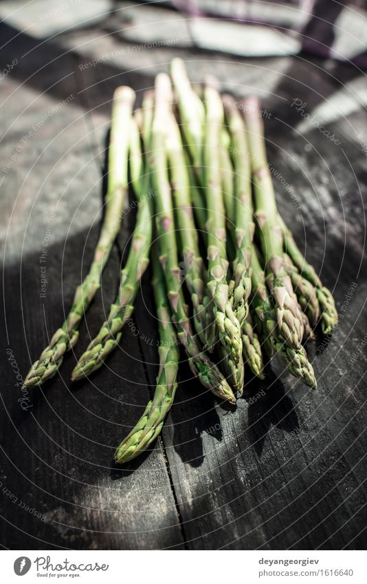 Asparagus on vintage table Green Dark Wood Fresh Nutrition Table Cooking & Baking Kitchen Delicious Vegetable Meal Vegetarian diet Diet Raw Ingredients Rustic