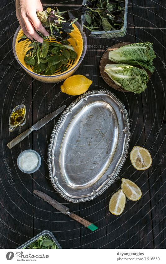 Preparing salad of herbs and lettuce Vegetable Herbs and spices Eating Diet Bowl Table Kitchen Simple Fresh Natural Green Salad food healthy Rustic preparing
