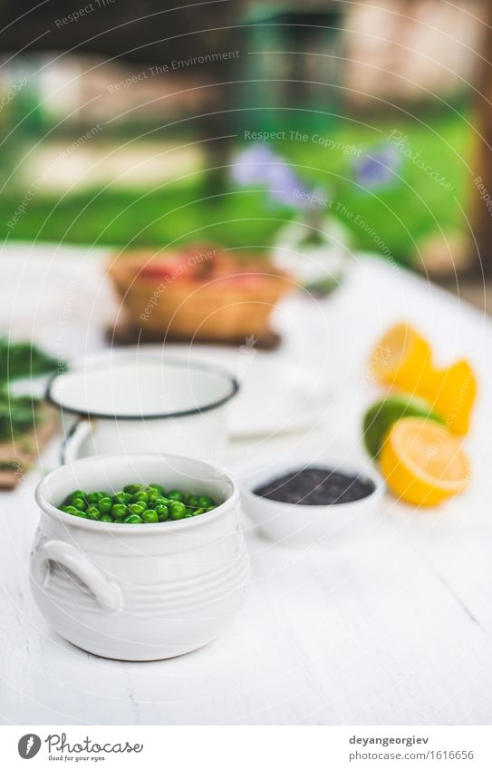 Peas in a bowl on white wooden table Vegetable Vegetarian diet Bowl Table Group Plant Wood Fresh Natural Green White background food agriculture seed Organic