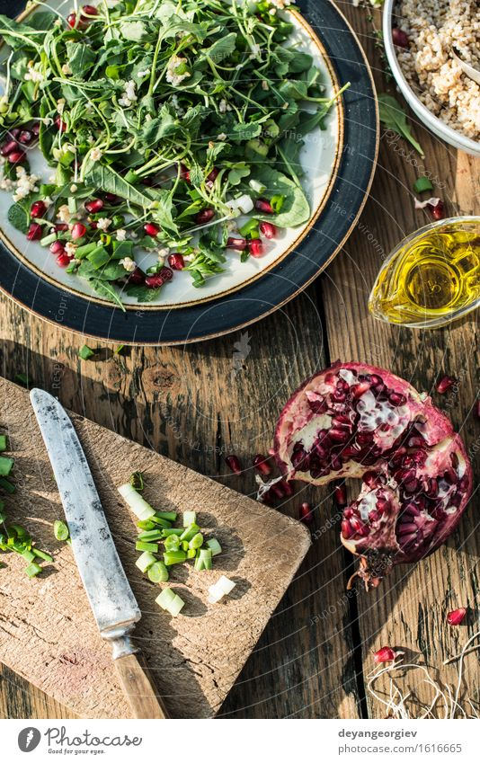 Green salad with pomegranate, manna croup, onion Green White Red Black Eating Fresh Nutrition Kitchen Vegetable Plate Bowl Meal Vegetarian diet Dinner Diet Lunch