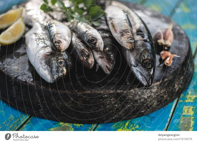 Raw fish. Sea bream, sea bass, mackerel and sardines. Seafood Lunch Pan Cook Fresh Blue Black Lemon Fat Mackerel Ingredients Sardine Meal Dish Exterior shot