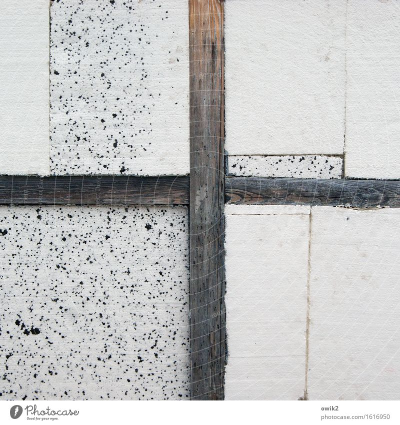 entablature Wall (barrier) Wall (building) Joist Wood Sign Styrofoam Crossed Crucifix Sharp-edged Simple Gloomy Colour photo Subdued colour Exterior shot Detail