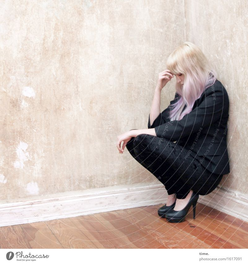 . Room Parquet floor Feminine 1 Human being Wall (barrier) Wall (building) Suit High heels Blonde Long-haired Think Crouch Sit Beautiful Patient Calm Sadness
