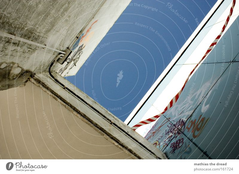 DANGER ZONE Sky Blue Bright House (Residential Structure) Canyon Worm's-eye view Wall (building) Building Architecture Concrete Town Barrier Judder Unreliable