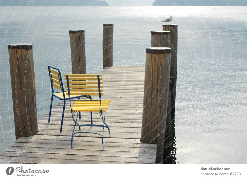 have a seat Autumn Chair Calm Water Mountain Alps Swiss Alps Light Shadow Switzerland Lake Loneliness Yellow Blue Gray