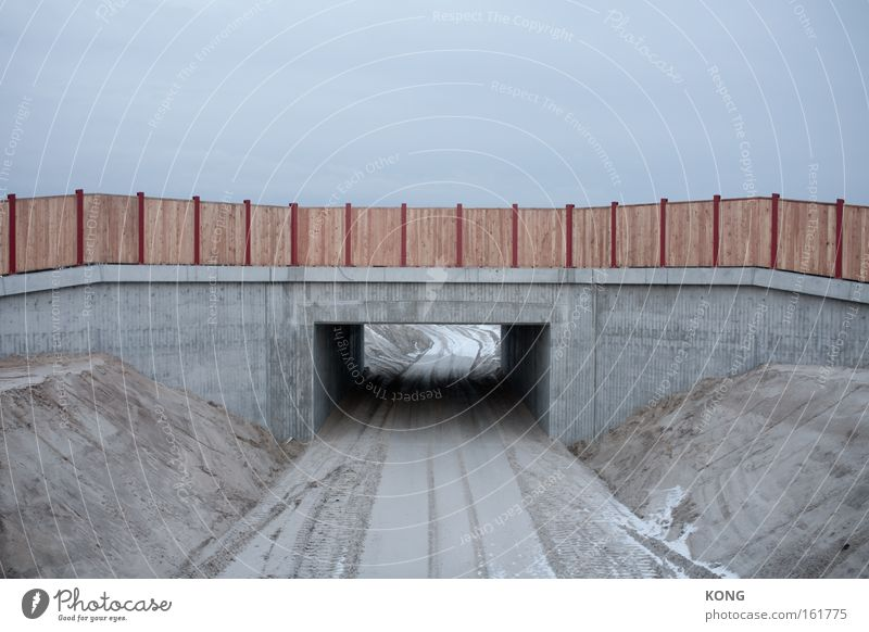below the horizon it goes on Construction site Bridge Gray Dreary Concrete Cold Border Passage Breach Hollow Gloomy Colorless Badlands Incomplete Boredom Earth