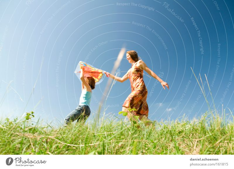 Summer on the march Spring Movement Walking Playing Sun Sky Meadow Sunbeam Girl Child Kiting Joy