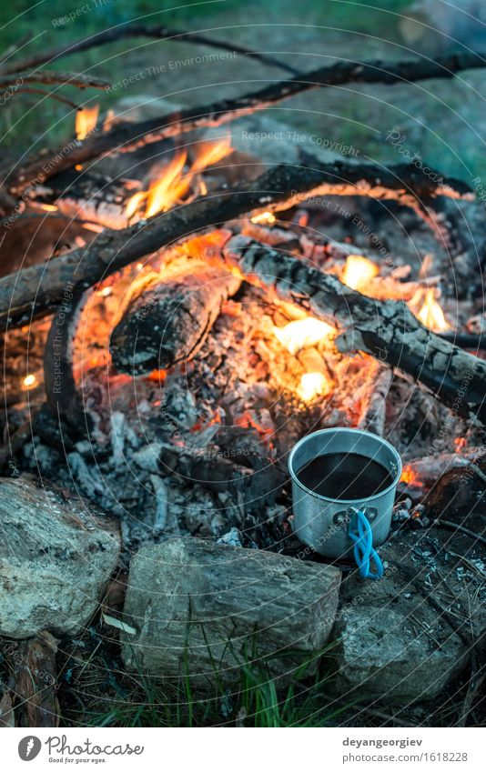 Making coffee on campfire in the forest Coffee Tea Pot Vacation & Travel Adventure Camping Summer Nature Forest Metal Steel Old Make Hot Natural Black Fireplace