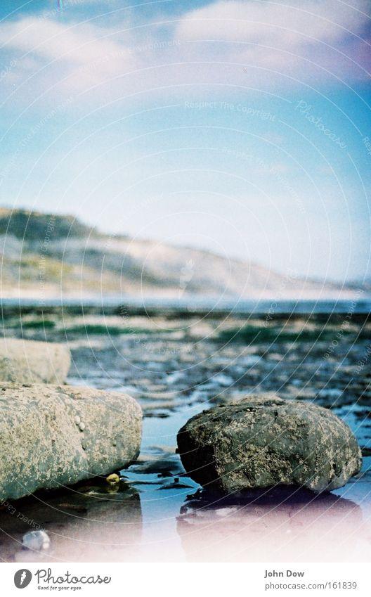 Nature Water Ocean Landscape Calm Clouds Beach Coast Stone Rock Rain Wet Beautiful weather Longing Wanderlust Puddle