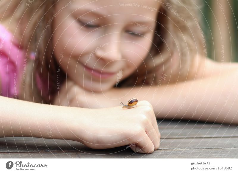 new girlfriend | Smiling girl with little snail on her hand Feminine Child Girl Infancy 1 Human being 3 - 8 years 8 - 13 years Environment Nature Animal Summer