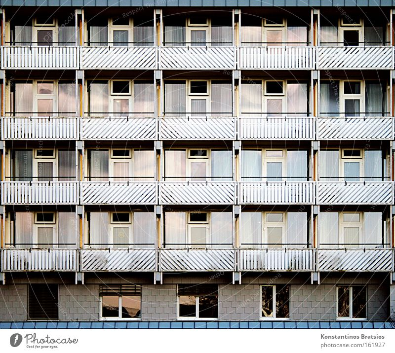 living in a case Colour photo Exterior shot Pattern Front view Cure Manmade structures Building Balcony Window Door Glass Town Protection Society Life