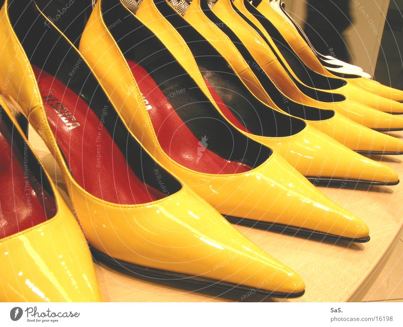 post fashion Yellow High heels Footwear Goods Trade Shelves Shoe shop Clothing Landing Tall pointy Fashion