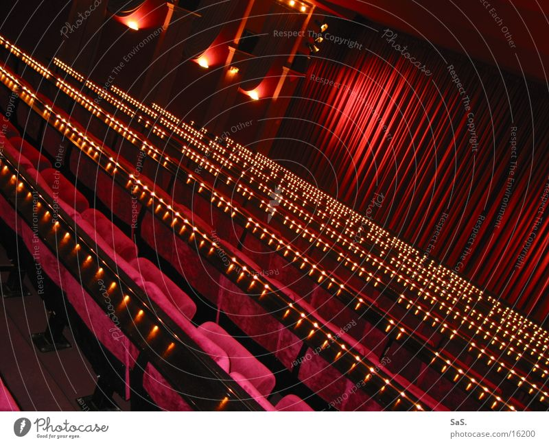 Dream Palace 10 Cinema Film industry Light Dark Red Black Armchair Movie theater seat Movie hall Going out Leisure and hobbies Culture Film premiere Stage Drape