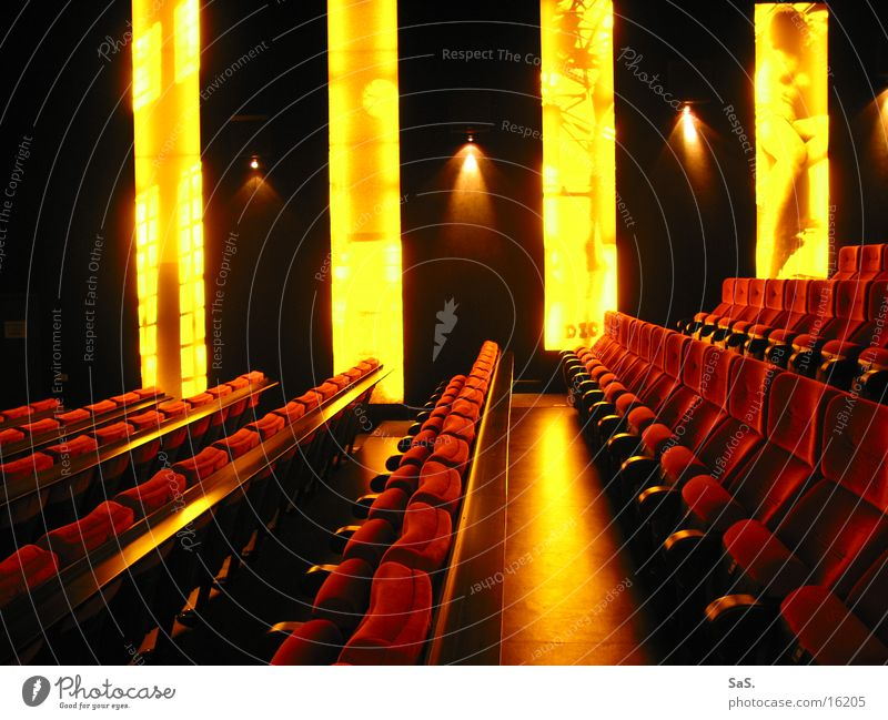 Dream Palace 5 Cinema Film industry Light Dark Red Yellow Black Armchair Movie theater seat Movie hall Going out Leisure and hobbies Wall of light Culture
