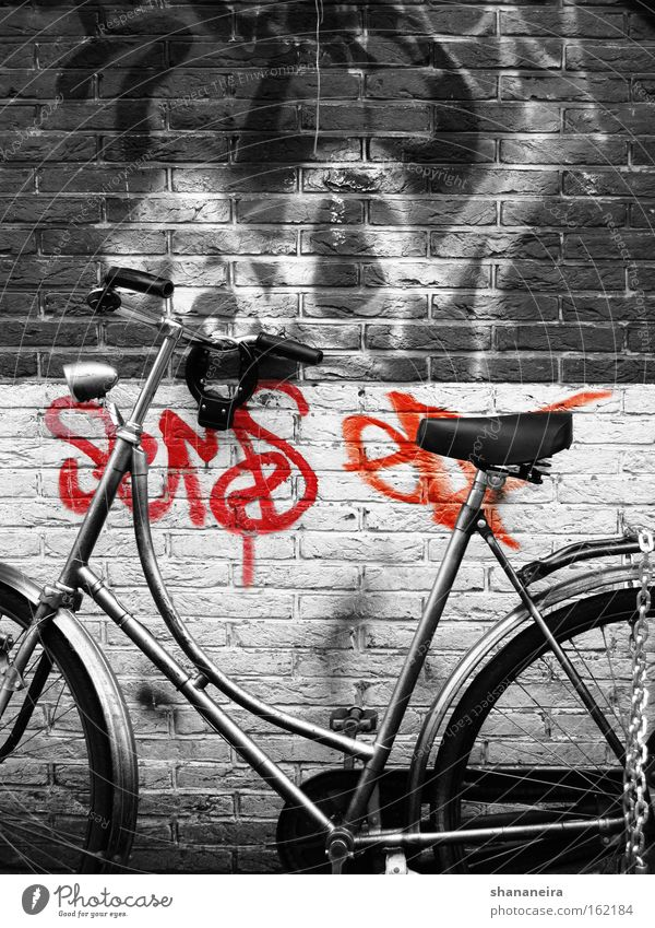 Amsterdam cliche Bicycle Wall (barrier) Wall (building) Graffiti Movement Wheel Bicycle handlebars Handlebars Netherlands Chain Brick wall Black & white photo