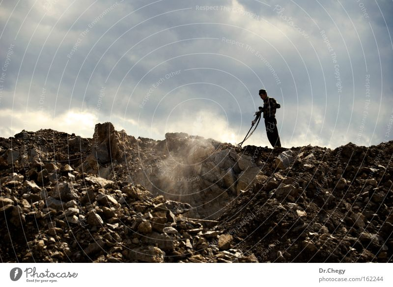 Hard Work Man Works Stone Hill Clouds Dust Sky Digging Grinder Drilling rig Industry Might worker labor driller