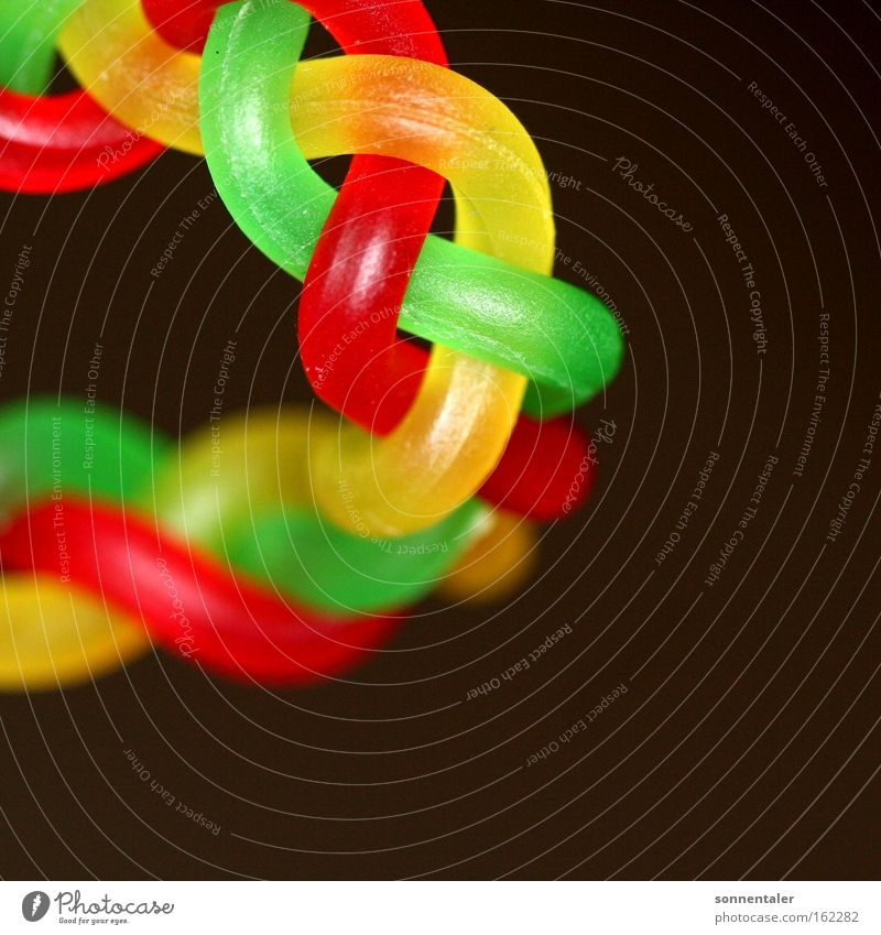 confectionery chain Candy String Multicoloured Red Green Yellow Sweet Chain Plaited Braids Connection Colour Muddled Loop Coil Macro (Extreme close-up) Close-up