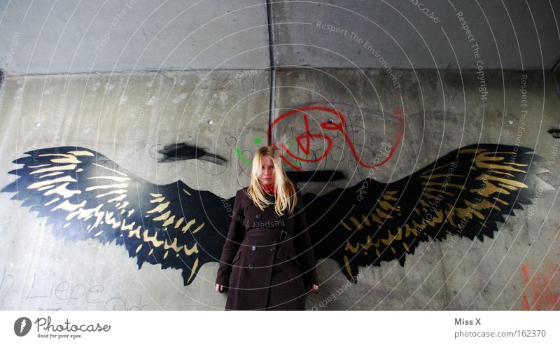 angels Colour photo Exterior shot Young woman Youth (Young adults) 18 - 30 years Adults Tunnel Wall (barrier) Wall (building) Underground Blonde Wing Graffiti