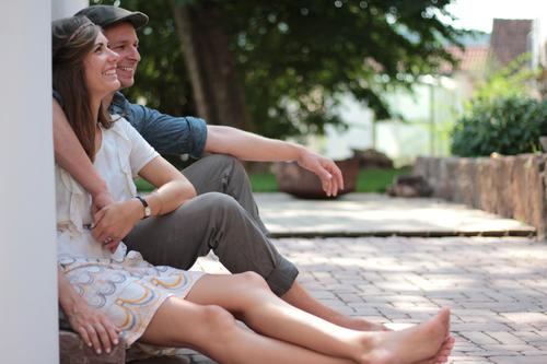 Human being Summer Tree Adults Wall (building) Wall (barrier) Garden Couple Authentic Happiness Bushes Dress Cap Hat Brunette Terrace