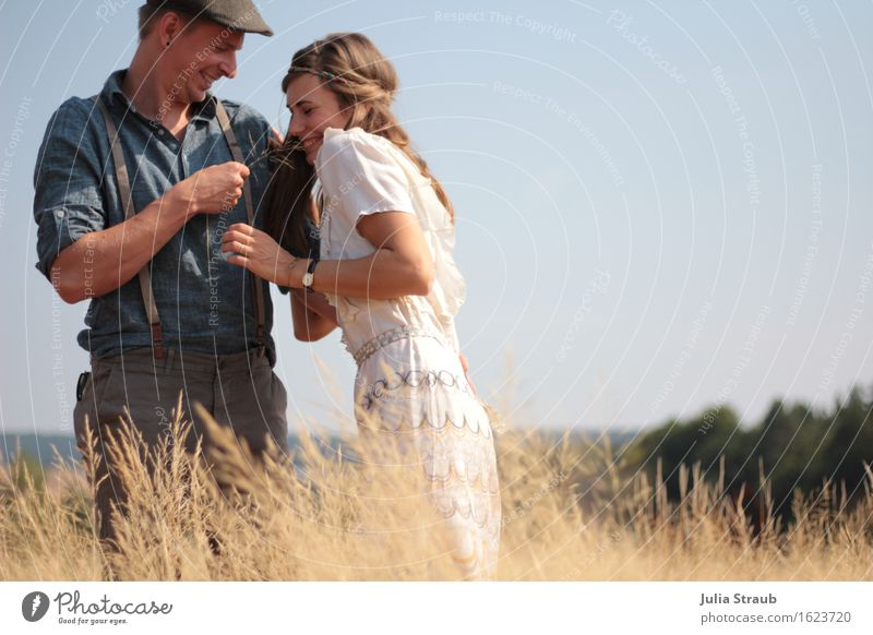 Human being Blue Summer Sun Adults Warmth Couple Brown Field Beautiful weather Dress Cap Hat Brunette Partner Enthusiasm