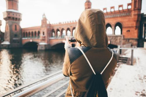 Young woman taking a picture of a bridge Lifestyle Vacation & Travel Sightseeing City trip University & College student Cellphone PDA Internet Feminine