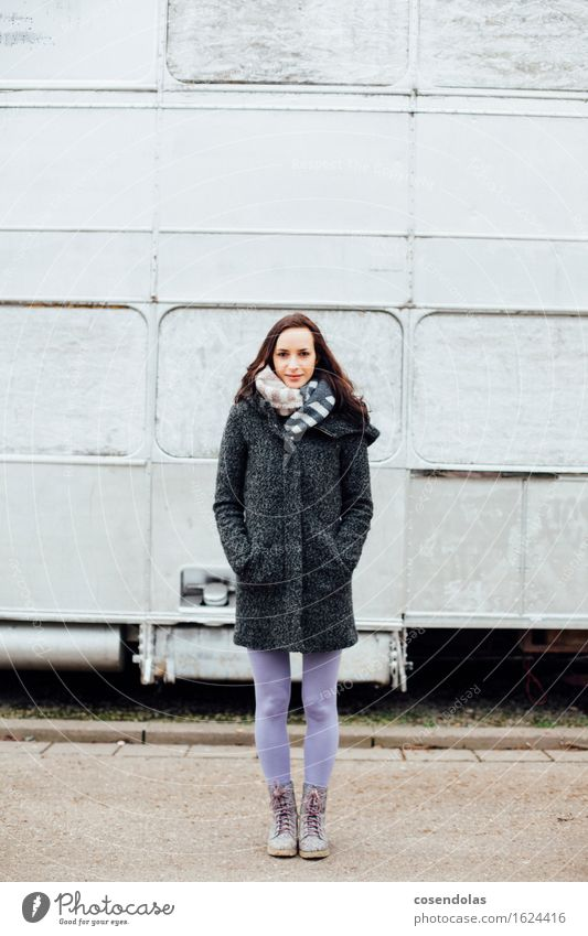 Young woman stands in front of a silver bus University & College student Feminine Youth (Young adults) 1 Human being 18 - 30 years Adults Jacket Coat Boots