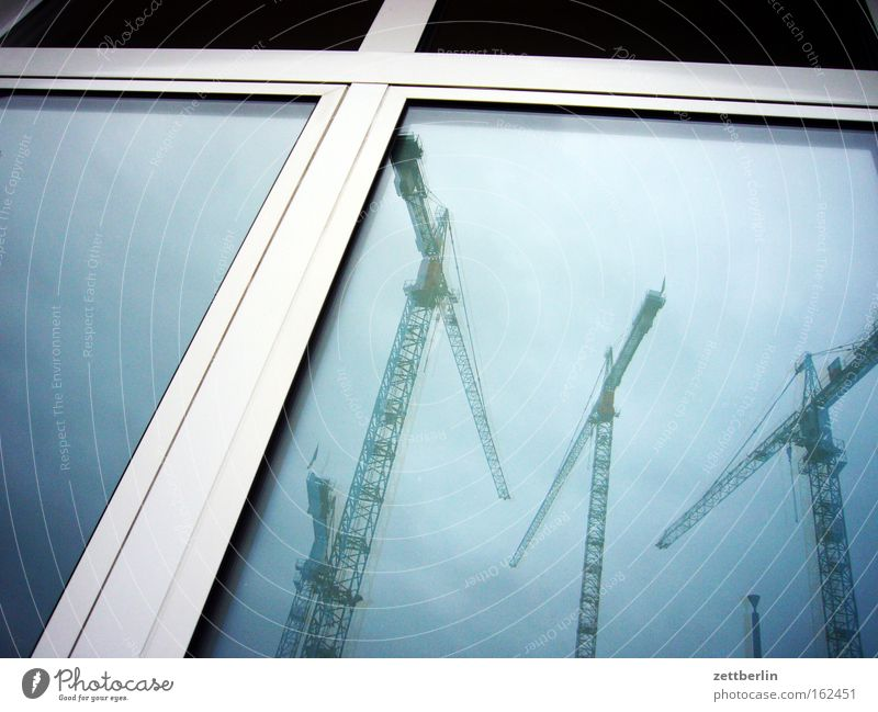 Building on, building on Crane Construction site Industrial Photography Industry Reflection Window Window pane Slice Glass Architecture Sky