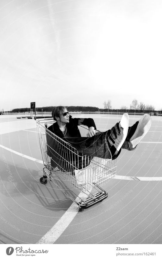 special offer Human being Man Easygoing Cool (slang) Parking lot Shopping Trolley Black & white photo Sit Line